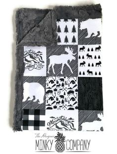 This stunning baby blanket has minky on both sides and would be perfect for any lumberjack, outdoor or woodland themed nursery. The top side is Pacific Northwest designer minky with blocks of bear, moose, trees, buffalo plaid, and more, in shades of black, gray, white. *The top is one solid piece of minky that has not been cut or quilted. The back and boarder of the blanket are our new charcoal hide minky. -This blanket is available in multiple sizes, please read size descriptions below and…
