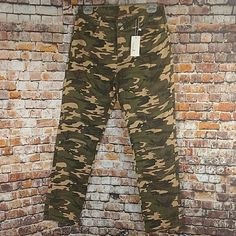 """Super cute distressed camouflage skinny jean. Distressed hole in each knee, Crystal rivets. Size large. 30"""" waist, 10"""" rise, 29"""" inseam. Green brown black tan.   eBay!"""