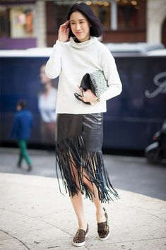 fringe, turtleneck, eva chen, midi skirt, black leather skirt, animal print sneakers, leopard sneakers, printed sneakers, slip-on sneakers, eva chen, editor style, editors, black and white, sneakers and skirts, sweaters and skirts