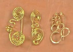 wire coil brooches - from Curvilicious Curlicues: 8 Tips for Forming Kink-Free Spirals, Coils, and Tubes with Wire and Metal Sheet - Jewelry Making Daily