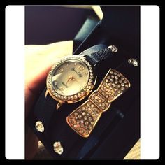Black Girly double strap watch 🎀💁 Two strap watch that snaps close. Black with beautiful gold hardware and large jewel studs. It's brand new, never worn so I can't show how it closes, it has the plastic closure underneath. jessica carlyle Jewelry