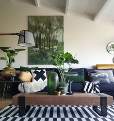 Monochrome in the living room with plants and artwork