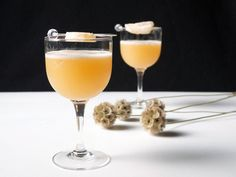 Fresh Ginger Amaretto Sour      1 (1-inch) knob of ginger, peeled and cut into 1/4-inch rounds     1 3/4 ounces freshly squeezed juice from 1 lemon     2 1/4 ounces amaretto, such as Disaronno     2 dashes Angostura bitters     1 egg white     Crystallized ginger, for garnish