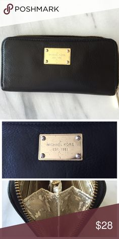Michael Kors Black Jet Set Zip Around Wallet Black soft leather Michael Kors wallet. Outside in very good condition because I sprayed with leather protectant when I first bought it. 8 card slots. Classic MK cloth lining in the pockets inside the wallet as well as the coin purse area. Parts of gold lining is flaking off.  Gold hardware name plate and zipper has some scratches. Ask all questions before purchase. Not accepting trades at this time, thanks! Michael Kors Bags Wallets