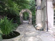 Backyard stone arch entrance #landscaping #architecture