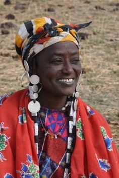This lady was sitting beside a lake with her friend stripping reeds - Burkina Faso. (Lake lady by Rhoda1)