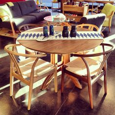The Modern Extendable Round Dining Table $2,695 & Paper Cord Dining Chair $425, European Oak.
