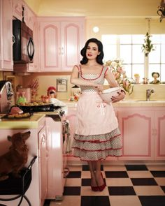 Dita (?) Retro Apron and a retro pink kitchen - what's not to love! S~)