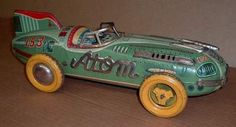 Sell one like this  OLD YONEZAWA TOY ATOM RACE CAR Big 16 Inches Long Tin Jet Racer Japan Friction