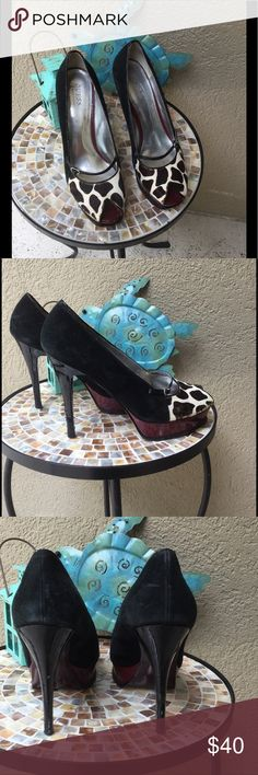 """🆕Guess calf hair toe black upper & red sole heels Super sexy Guess heels with a calf hair peek a boo toe, black upper & metallic crimson sole❣️These are show stoppers! 1"""" Platform & 5"""" heels. A few mars in a couple places zoom in on pics to see condition. GUC ✅I ship same or next day ✅Bundle for discount Guess Shoes Heels"""