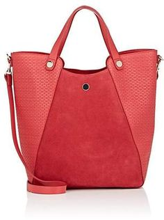1aeb914f023 Halston Heritage s bucket bag is crafted of red textured leather detailed  with center panels of red