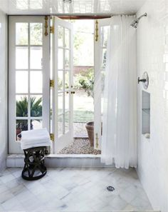 Shower with a french door leading into the backyard.. Who comes up with things like this? I love it!