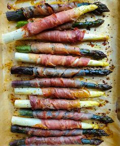 This appetizer or side dish couldn't be easier! Wrapping asparagus with slices of prosciutto and roasting till crispy takes mere minutes. Finish with sumac and a copious dusting of parmesan cheese. #asparagusseason #asparagusappetizer #asparagustoastsoldiers #prosciuttowrappedasparagaus