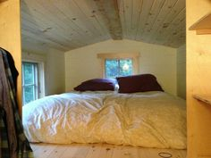 A self-built tiny house on wheels in Northern Vermont. Clever sleeping loft storage!