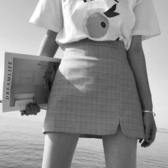 woman girl standing black and white holding magazine bracelet short skirt negative saturation sadness sad dark depressed jamais vu aesthetic
