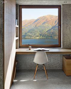 In Brissago, Switzerland, the kitchen of a vacation house by Wespi de Meuron Romeo Architetti overlooks Lago Maggiore. Photography by James Silverman.