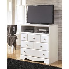 A beautiful white finish adds a bright, cheerful look to this handsome media stand from Signature Designs by Ashley. Three deep drawers and two open shelves complete this versatile piece.