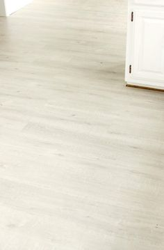 Gable Oak laminate flooring by Quick•Step featured in @bevrmccullough's kitchen transformation.
