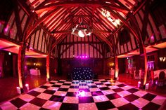 Black and white dance floor (image taken with a fish eye lens!) with LED colour changing up lighting around the venue to create ambience