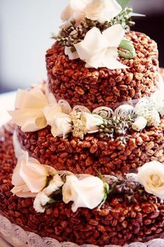 Chocolate puff wheat wedding cake decorated with lace and flowers. Photo by Eternal Reflections.