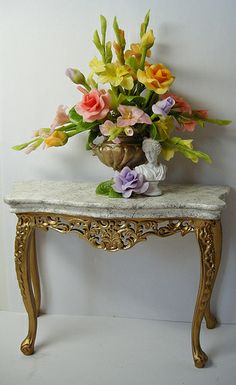 Stunning Marble and Gold Console Table with Floral Display