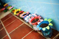 Handmade flower pots made of recycled plastic bottles