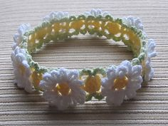 White and Yellow Daisies Crochet Headband Pattern by Elena Chen.