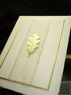 """handmade wedding invitation on  handmade paper ... ivory with touches of gold ... solid gold embossed leaf ... luv the wide gold edged chiffon  """"Christmas ribbon"""" colum ... elegant card ..."""