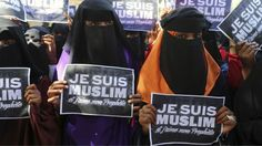 University students hold placards during a demonstration against satirical French weekly Charlie Hebdo.