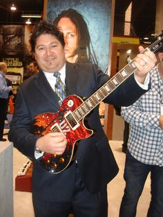 some fat guy playing the Edge's Les Paul....
