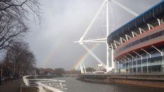 Two rainbows behind Cardiff's Millennium Stadium, Cardiff, South Wales, UK