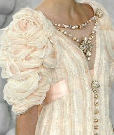 Thats a cool sleeve. Thats a cool sleeve I could DIY… If you can make a fabric rose, you can totally knock this out.  (via High Fashio...