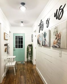 "Love the use of photos and ""This is Us"" on the Wall. Door color and flooring is beautiful! #farmhouse #walldecor"