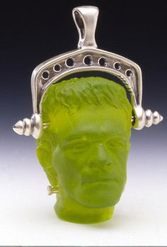 Gregg Burgard. Gregg's Halloween-inspired glass Frankenstein bead with sterling neck bolts and a silver bail