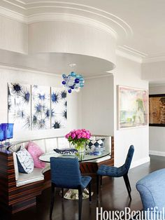 Nisbet tucked a Macassar ebony banquette into the combined living and dining rooms of a New York apartment.