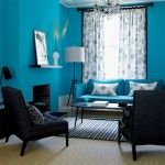 Calm Blue Themed Living Room Interior Design with Blue Fabric Sofa Set feat White Flowers Motife Pillows near Coffee Table Idea and Double Black Sofa Idea and Drum Shaped White Floor Lamp a part of  under Living Room
