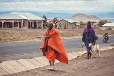 A street view from Arusha. The Maasai herdsmen in their colorful wear bringing a goat to the marketplace. Arusha, Tanzania, Fine Art Photography, Goats, Around The Worlds, Street View, Portraits, Colorful, Art Photography