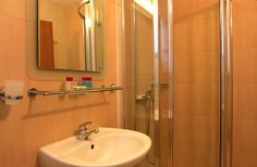 There are 2 double sized bedrooms and 2 shower rooms and a downstairs loo with washbasin.