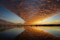 More than 500 spectacular Australian landscapes, caught during Mother Nature's most breathtaking conditions, have been entered into The Weather Channel 2013 calendar contest.  The public can vote for the contest's top 25 photos on Facebook.  Taken at dawn, Corio Bay, Geelong. A spectacular display of alto cumulus clouds. Picture: HEATHER PRICE, Geelong VIC