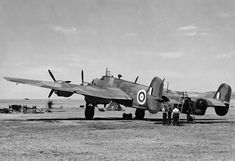RAF BOMBER COMMAND. Handley Page Halifax Mk I L7245, the second prototype aircraft, at Radlett, Hertfordshire, 1940. Part of: MINISTRY OF INFORMATION SECOND WORLD WAR CENSORSHIP BUREAU LIBRARY OF PRESS PHOTOGRAPHS Source: © IWM (HU 107763) Ww2 Aircraft, Military Aircraft, Handley Page Halifax, World History, History Pics, Nose Art, Royal Air Force, World War Two, Wwii