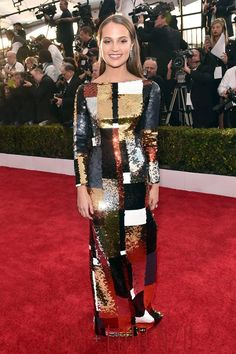 This dress is both sophisticated and a lot of fun. The mixing of browns and greys is terrific, and not a usual colour palette for these types of things. (Alicia Vikander, Louis Vuitton)