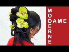 Moderne Dame Hochsteckfrisur mit Blumen für Frühling.