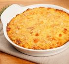 traditonal gateau potatoes pie with cheese and nutmeg. served in a terrine over a wooden board Greek Recipes, Indian Food Recipes, Ethnic Recipes, Potato Pie, Potato Recipes, I Love Food, Good Food, Salmon Pie, Bacon