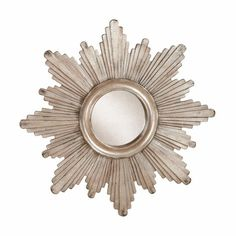 "A classic design with a modern twist, this modestly sized mirror gets its unique scalloped silhouette from ""rays"" of various lengths and heights. A hand-applied aged silver finish gives each piece distinctive character. At the center, a coordinating band surrounds the antiqued mirror glass for a three-dimensional effect."