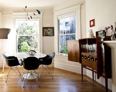 eames chairs and what an incredible drinks cabinet