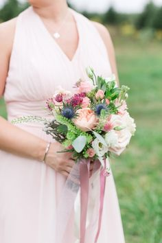 bridesmaid bouquet in peach and pink with blue thistle