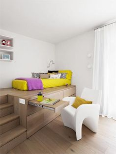 """Lounge space + extra storage for tiny space. Love the pullout table, the bed ON TOP of the built in """"dresser"""", the steps up to the bed also may hold storage."""
