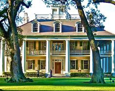 This plantation is french colonial with elements of Greek revival.