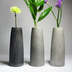 """MU Concrete Vessels are architecture-inspired forms cast in industrial strength concrete.Pylon Vase is hand cast in concrete, molded from an original model by Janny Baek. Vases hold one 20mm pyrex glass tube (included). Concrete exterior is lightly polished and sealed with beeswax.height: 10"""" weight: approx. 4 lbsNot intended for outdoor use. Heavy. Concrete.Note: Because Concrete Vessels are hand cast in small batches, there may be slight variations in color ..."""