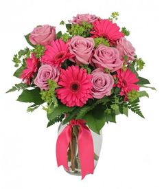 Lovely lavender roses & dazzling hot pink gerbera daisies! www.uniqueflowerfashions.com/product/ao040715a/hopeless-romantic #ValentinesDay #NashvilleFlorist